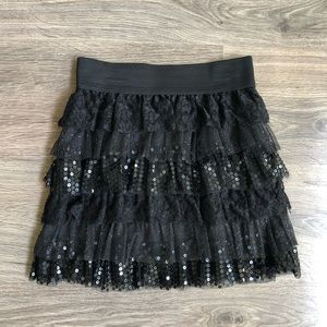 Black sequins ruffled skirt.